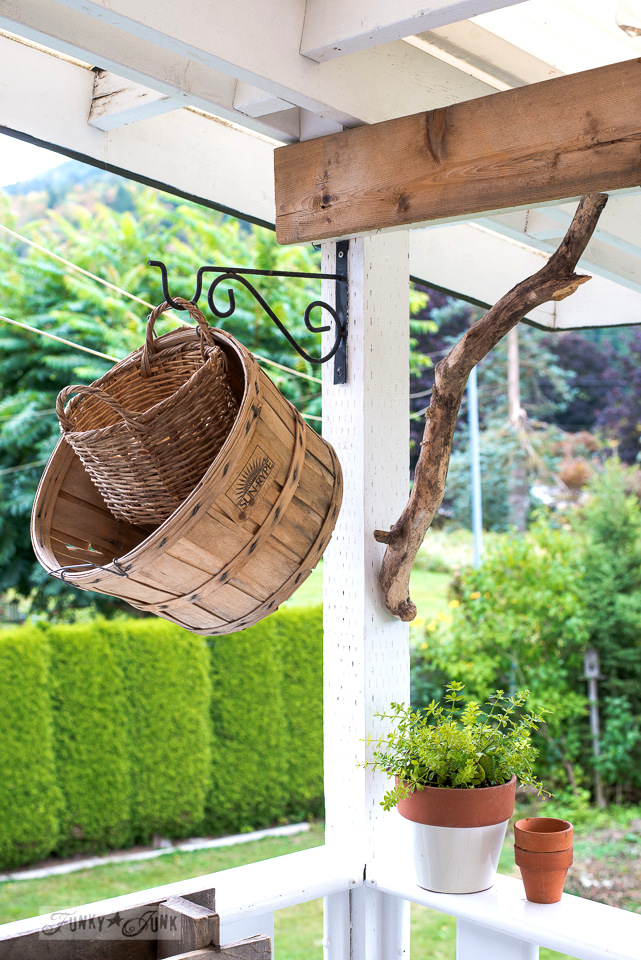 rustic laundry baskets and branch corbel on a patio | funkyjunkinteriors.net