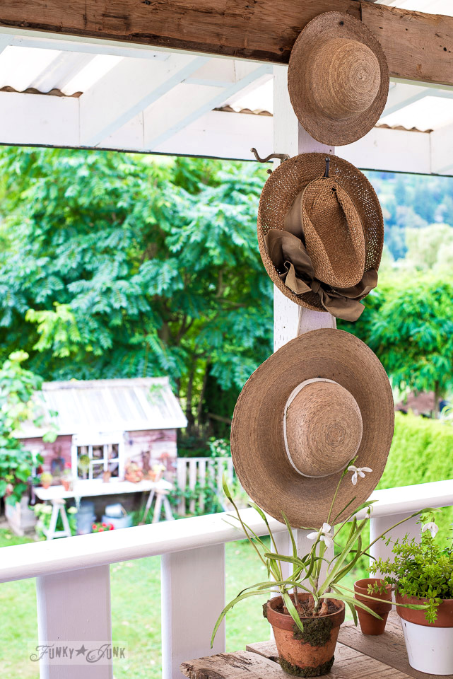 straw hat wall art on a summer patio | funkyjunkinteriors.net