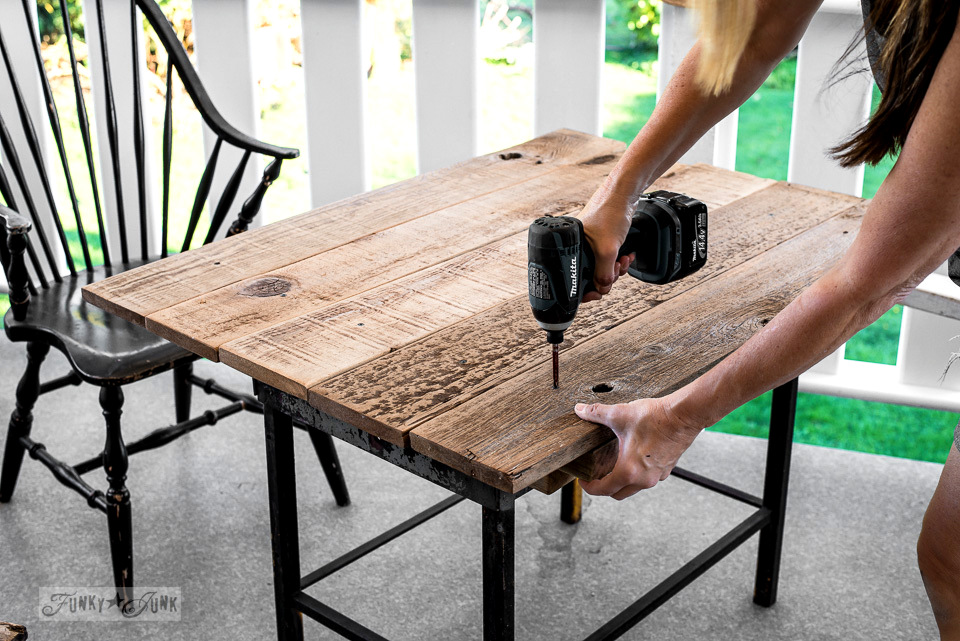 The making of a farmhouse styled patio table with reclaimed wood and a FARMHOUSE stencil, using Funky Junk's Old Sign Stencils | funkyjunkinteriors.net