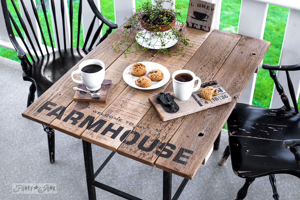 Learn how to make this Farmhouse styled patio table with reclaimed wood and a Farmhouse stencil! Click to full tutorial.