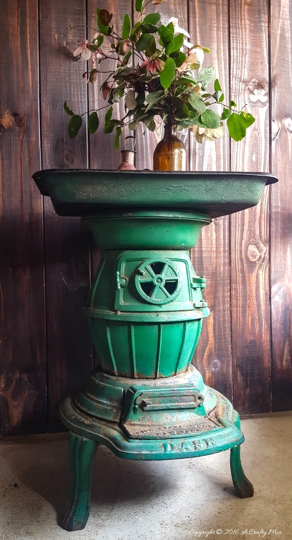 Cast iron wood stove side table, by A Crafty Mix, featured on Funky Junk Interiors