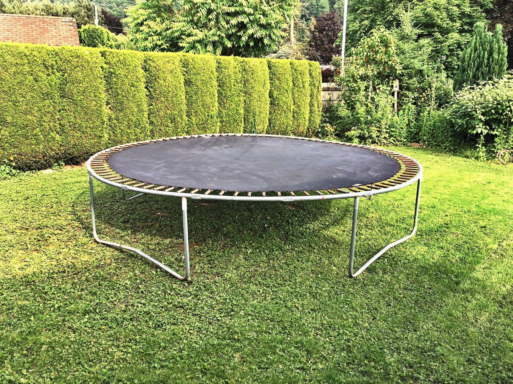Big 'ol trampoline in a yard | funkyjunkinteriors.net