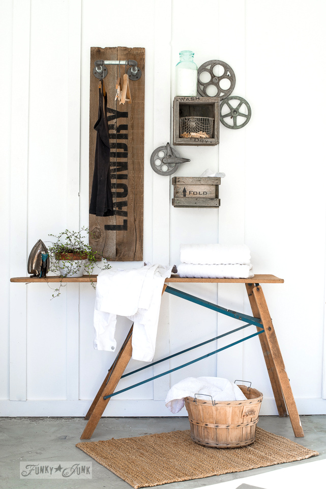 Learn how to create this productive AND cool industrial farmhouse reclaimed wood and pipe LAUNDRY sign hanging station with crate shelves, with Funky Junk's Old Sign Stencils! #laundryroom #funkyjunkinteriors #oldsignstencils