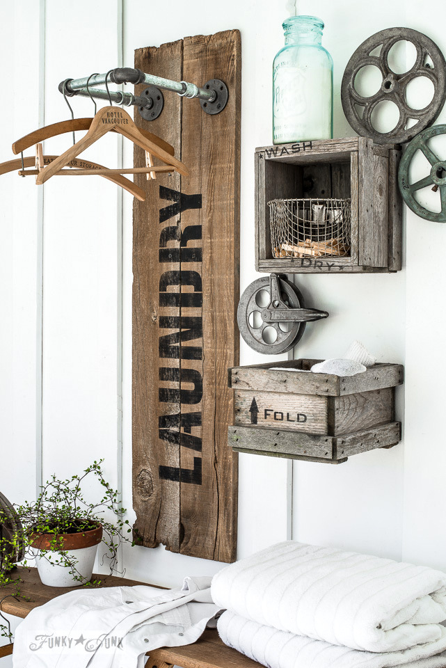 Pipe and reclaimed wood farmhouse styled Laundry sign that hangs clothes, using Funky Junk's Old Sign Stencils | funkyjunkinteriors.net