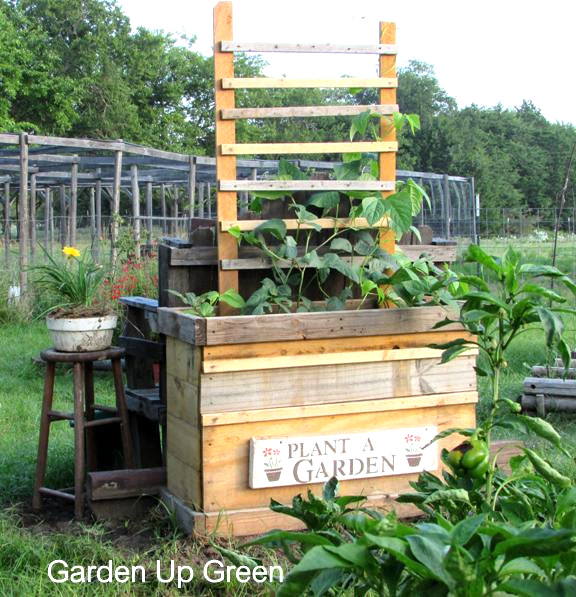 Reclaimed wood raised garden flowerbed, by Garden Up Green, featured on Funky Junk Interiors