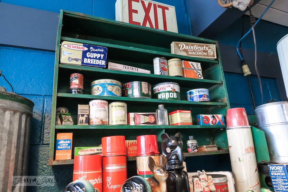 Antique tins and thermoses at Atomic Cat Antiques and Vintage, in Hope, British Columbia, Canada | funkyjunkinteriors.net
