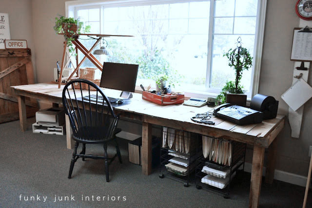 Rustic reclaimed pallet wood farm table office desk in an office | funkyjunkinteriors.net