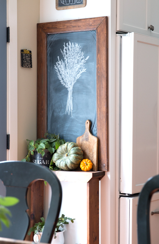 Fall wheat drawn chalkboard, lined with the perfect pumpkin vignette, by Finding Home Farms, featured on Funky Junk Interiors