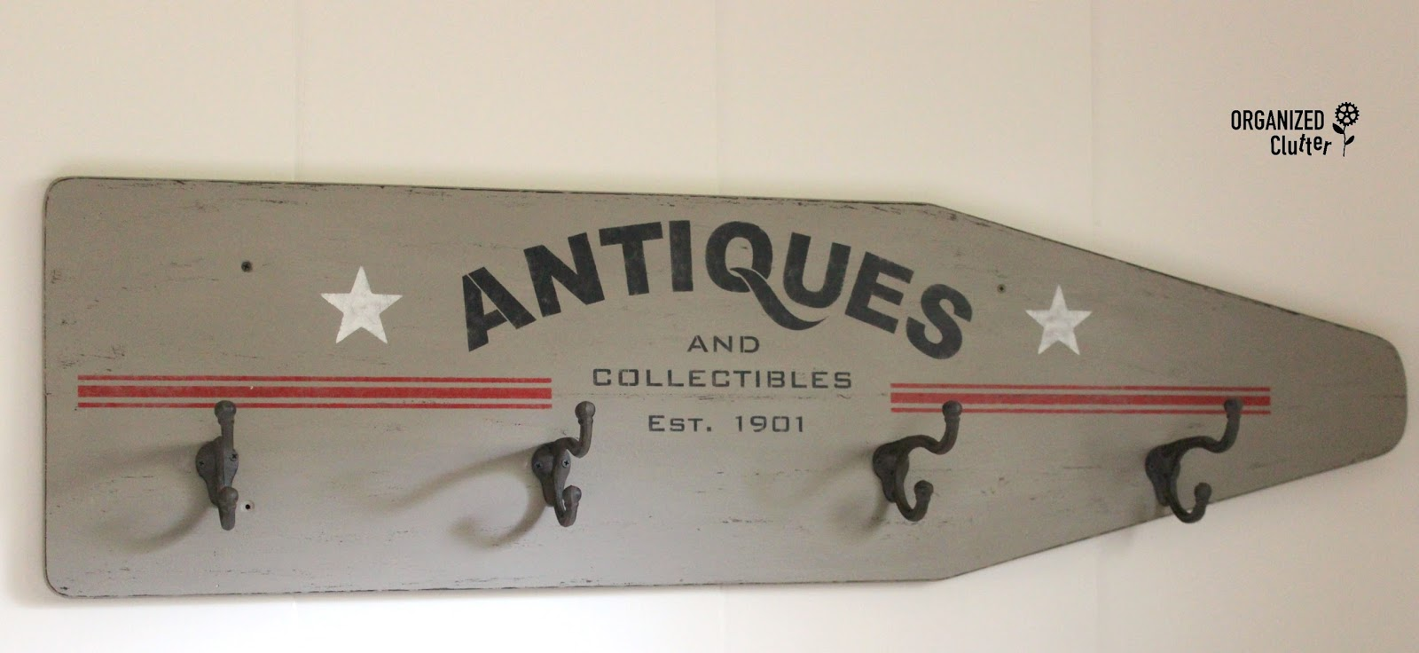 Vintage ironing board coat hook ANTIQUES sign, by Organized Clutter, featured on Funky Junk Interiors