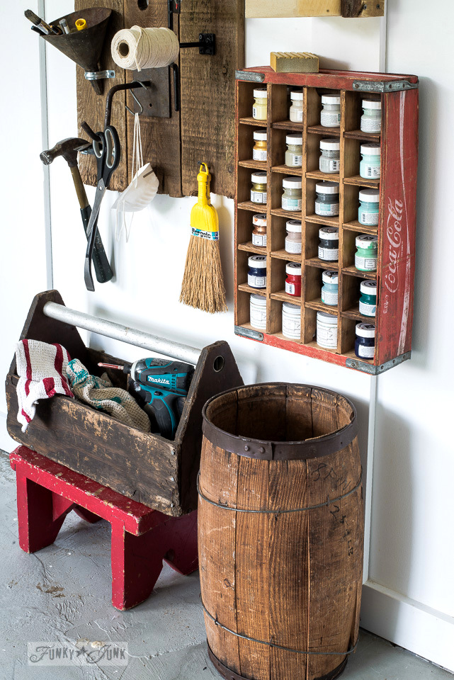 Coke crate paint storage, part of a sign themed tool and paint junk work station | funkyjunkinteriors.net