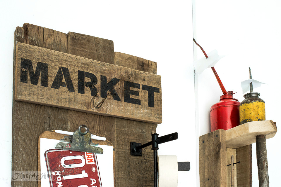 The making of a sign inspired reclaimed wood tool and paint work station from junk with oil can reciept holders | funkyjunkinteriors.net