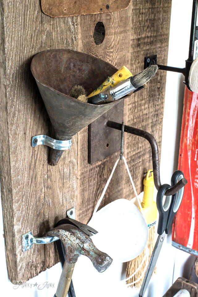 Rusty funnel as a pen holder, and door pull hammer holder, part of a sign themed tool and paint junk work station | funkyjunkinteriors.net