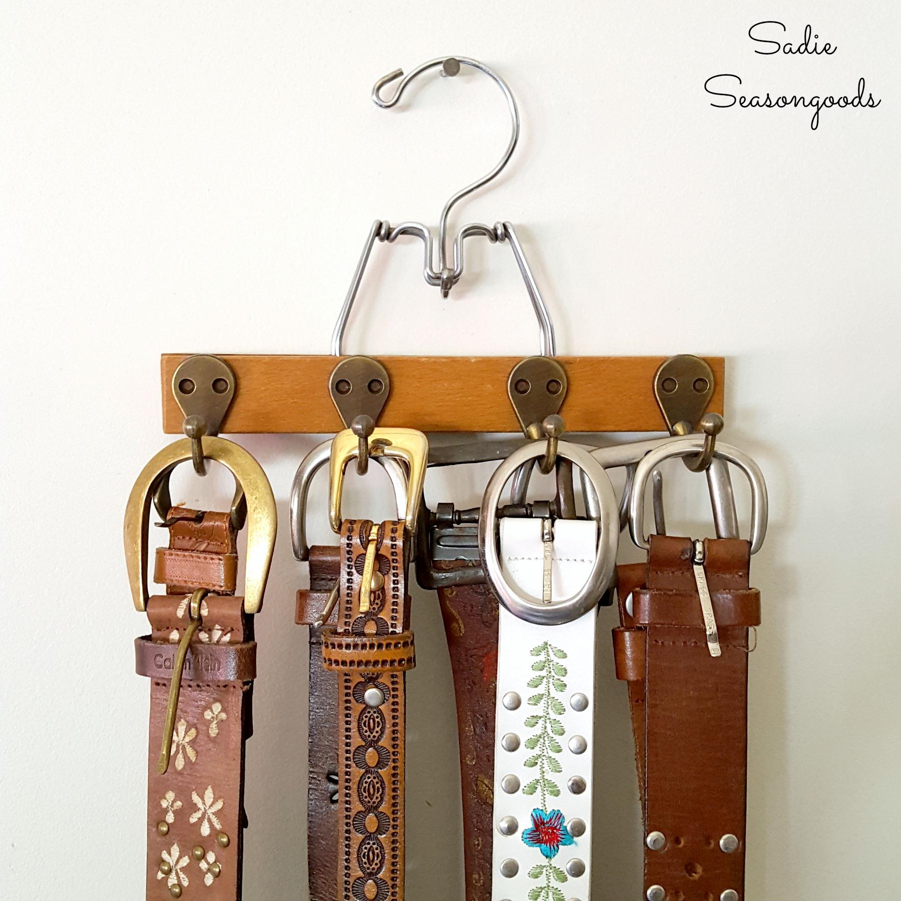 Vintage pant hanger turned belt organizer, by Sadie Seasongoods, featured on Funky Junk Interiors