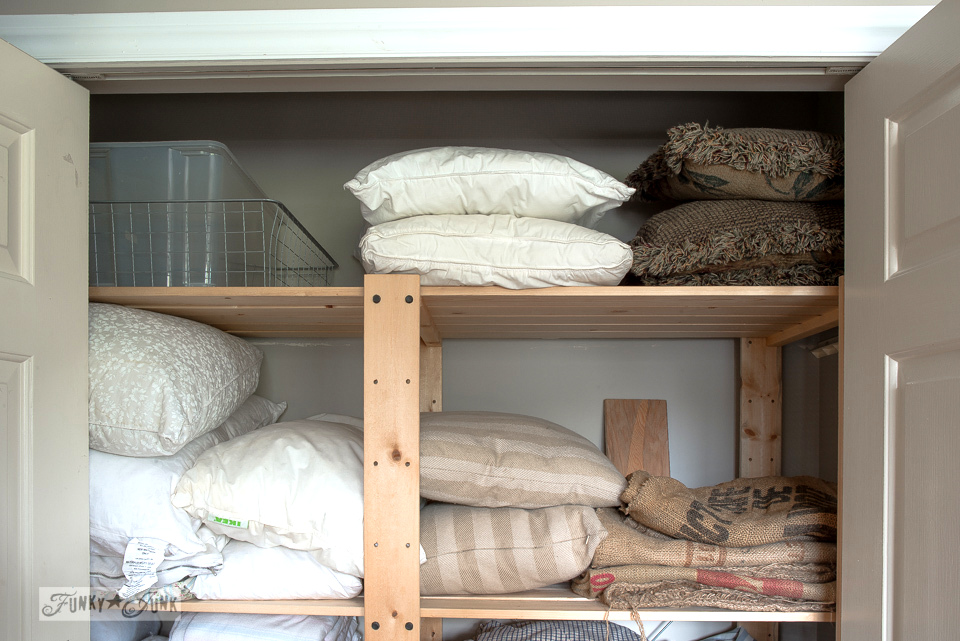 organizing the Gorm Ikea shelving inside the linen closet | funkyjunkinteriors.net