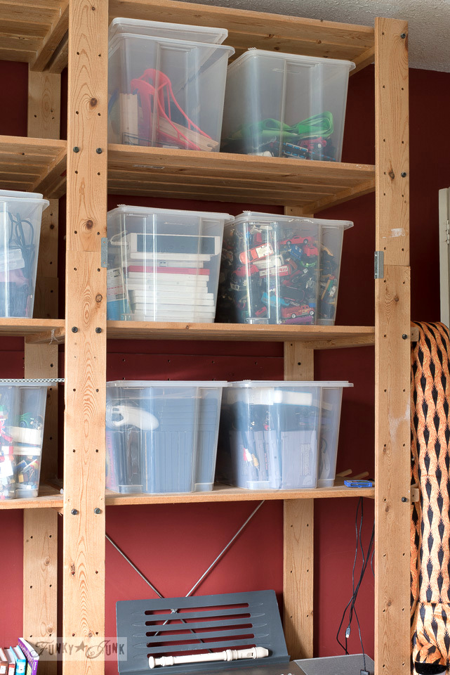 organizing the Gorm Ikea shelving with bins full of toys and gaming | funkyjunkinteriors.net