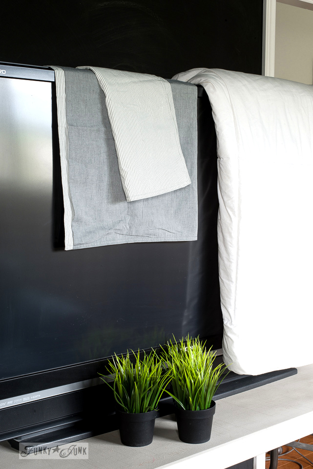 new grey and white pinstriped bedding from Ikea, and potted faux plants | funkyjunkinteriors.net