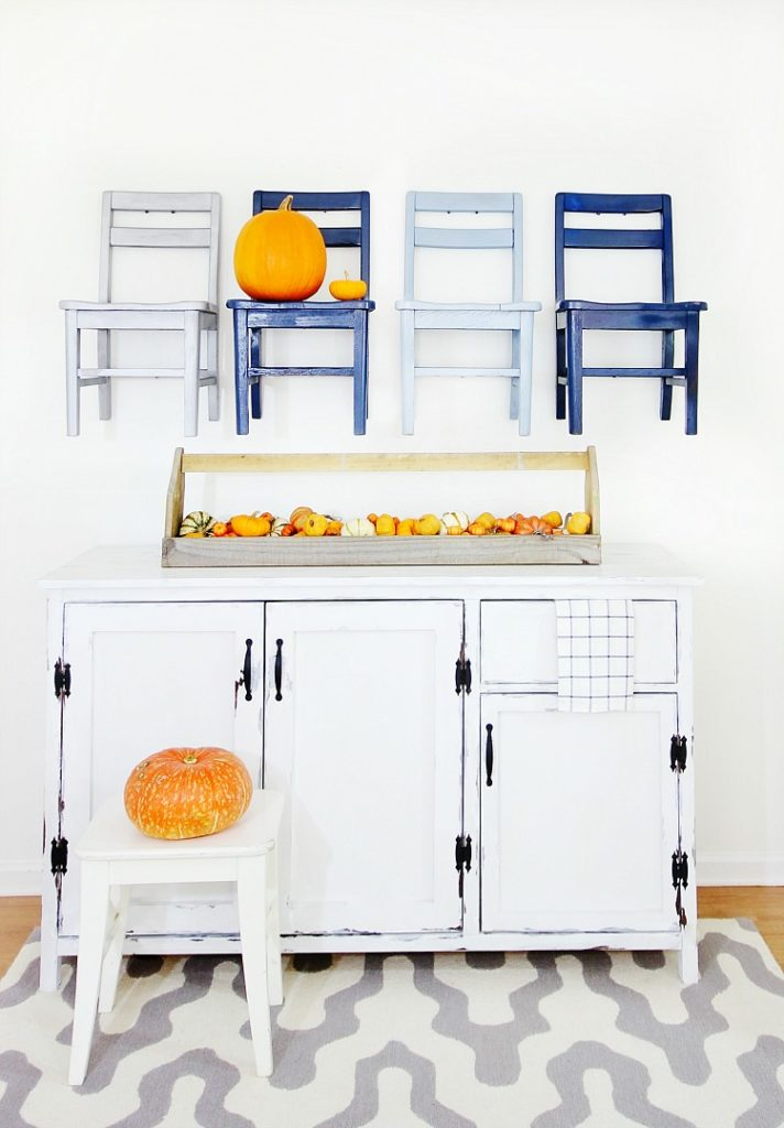 Chairs on a wall and toolbox fall pumpkins, by Thistlewood Farms, featured on Funky Junk Interiors