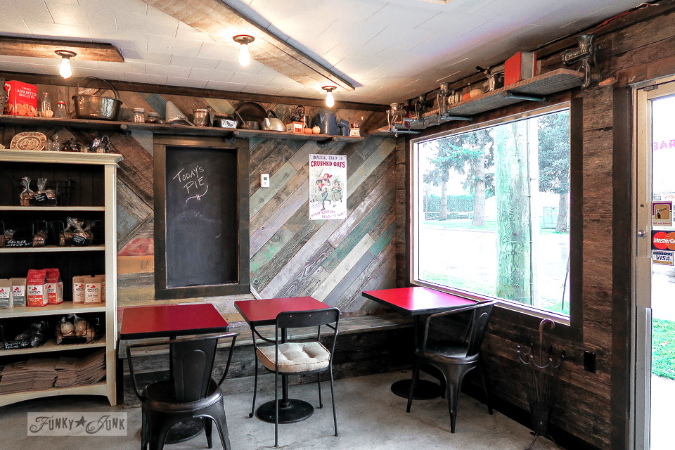 Reclaimed colourful wood wall, installed on an angle - Hazelsprings Organic Bakery, an industrial coffee shop in Chilliwack, BC Canada | funkyjunkinteriors.net