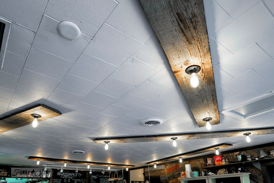 Rustic wood planks and exposed bulbs for lighting at Hazelsprings Organic Bakery, an industrial coffee shop in Chilliwack, BC Canada | funkyjunkinteriors.net