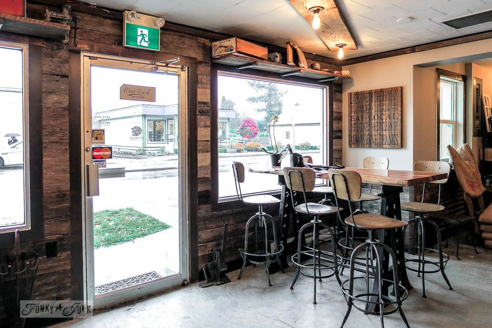 Industrial styled coffee shop with wood walls, metal and wood furniture - HazelSprings Organic Bakery, a coffee shop in Chilliwack, BC Canada | funkyjunkinteriors.net