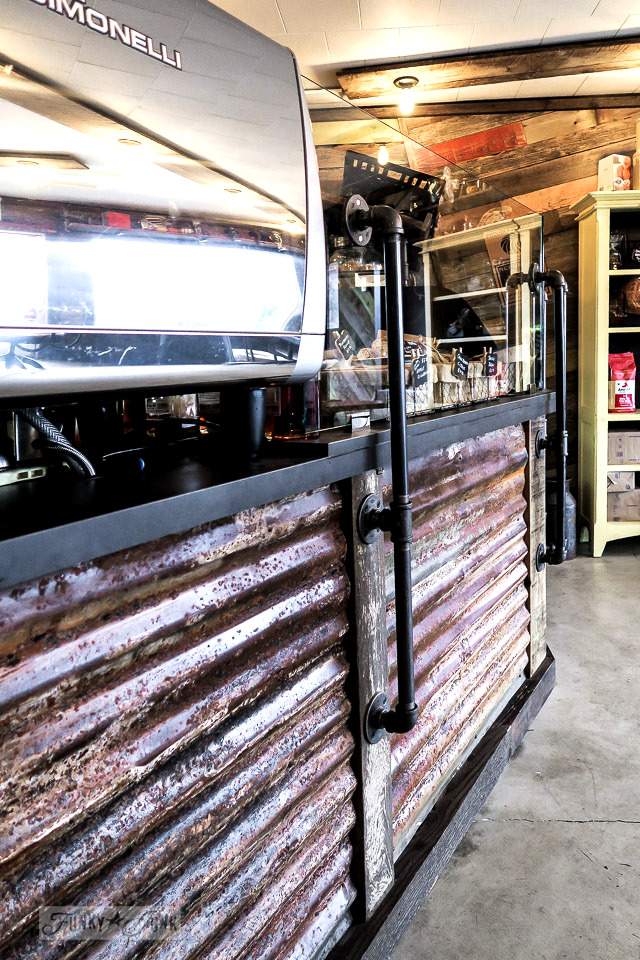 Metal siding from an old barn and pipe front counter at Hazelsprings Organic Bakery, an industrial coffee shop in Chilliwack, BC Canada | funkyjunkinteriors.net