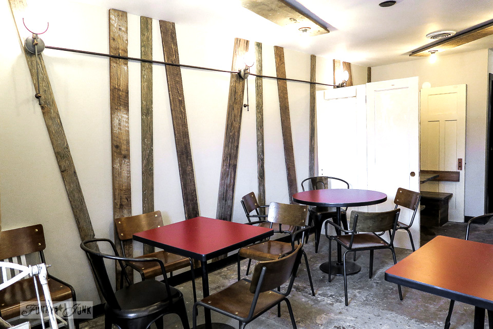 Reclaimed wood wall treatment with industrial exposed lighting at Hazelsprings Organic Bakery, an industrial coffee shop in Chilliwack, BC Canada | funkyjunkinteriors.net