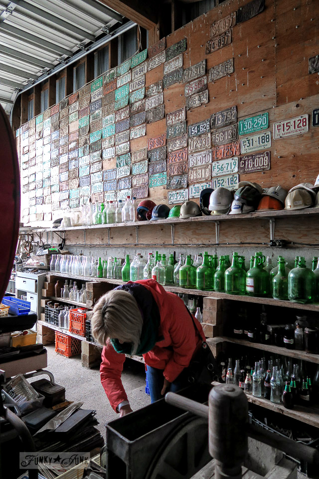 The license plate wall and antique bottle room at Granny & Grumpa's Antiques | funkyjunkinteriors.net