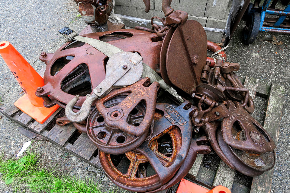 Huge rusty pully wheels at Granny & Grumpa's Antiques | funkyjunkinteriors.net