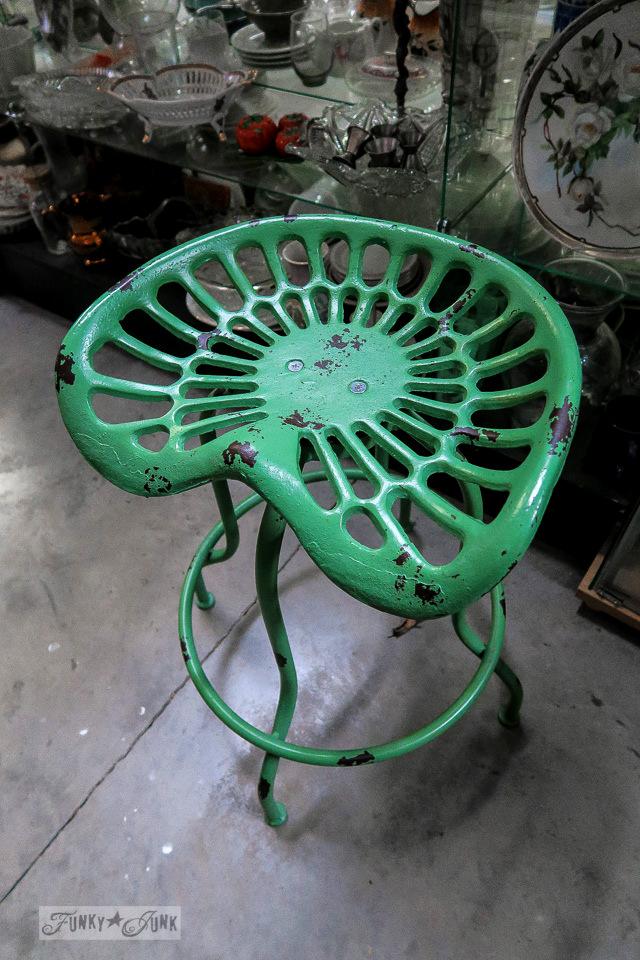 Vivid green antique tractor seat stool at Granny & Grumpa's Antiques | funkyjunkinteriors.net