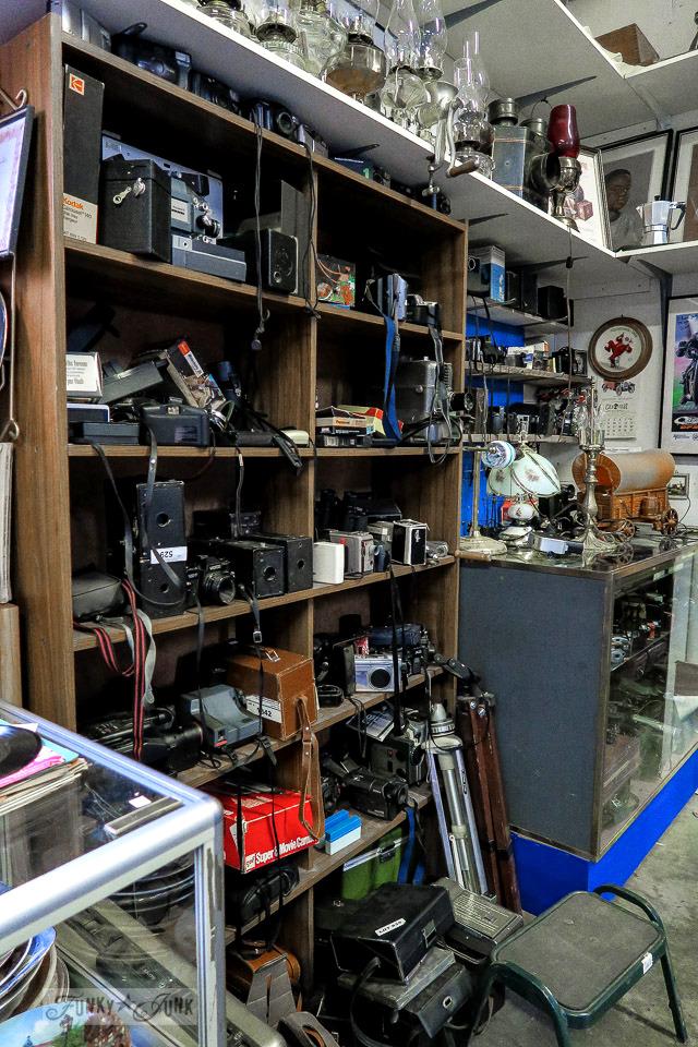 Shelves full of vintage cameras at Granny & Grumpa's Antiques | funkyjunkinteriors.net