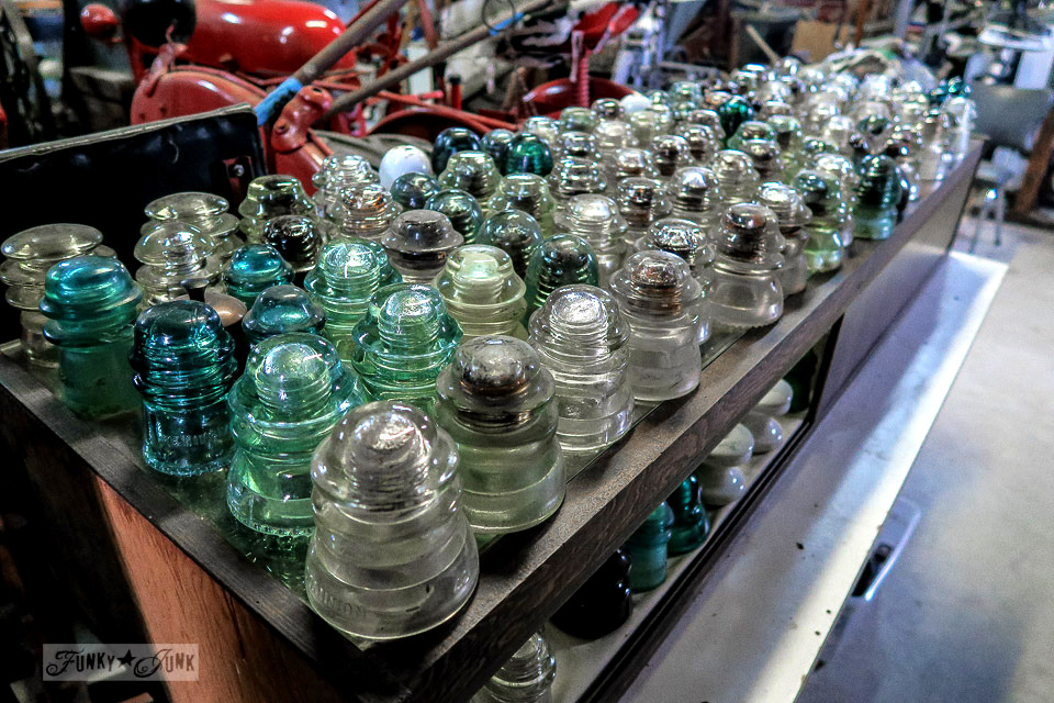 Shelves of antique glass insulators at Granny & Grumpa's Antiques | funkyjunkinteriors.net