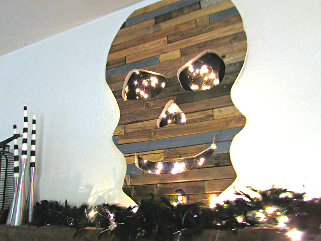 Reclaimed wood illuminated Halloween skull decor, by Bliss on a Budget, featured on Funky Junk Interiors