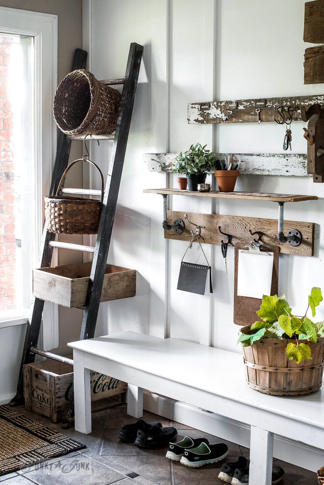 rustic wood ladder and basket storage for an entry | funkyjunkinteriors.net