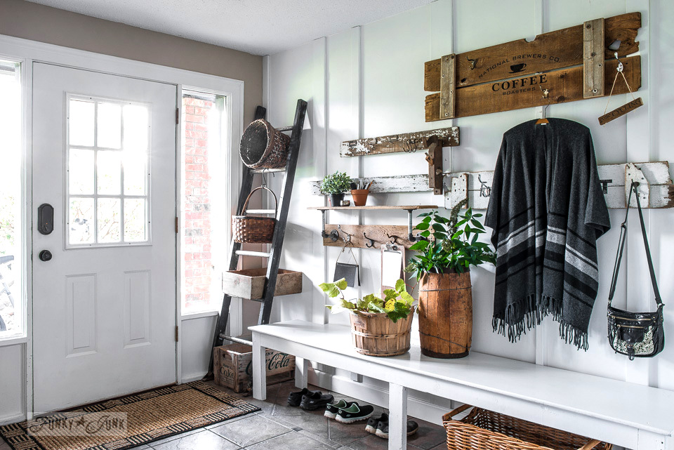 Ladder storage and old sign coat hooks for a rustic front entry | funkyjunkinteriors.net