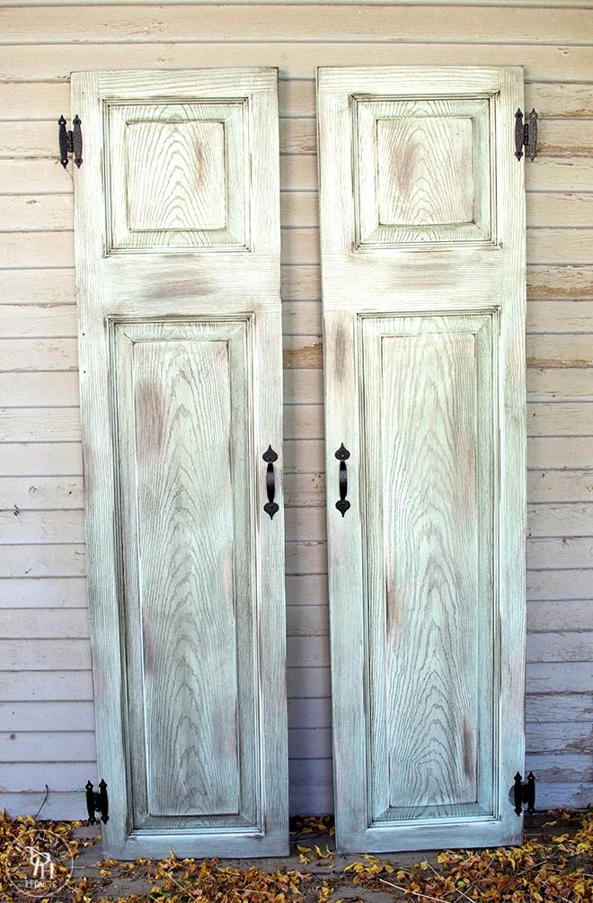 Repurposed door farmhouse shutters, by The Painted Hinge, featured on Funky Junk Interiors