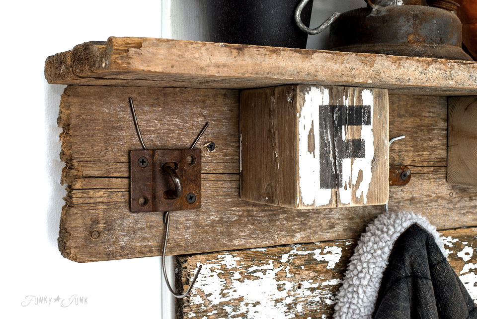 Assembling a reclaimed wood coat hook shelf with wire hanger hooks and FALL blocks using Funky Junk's Old Sign Stencils | funkyjunkinteriors.net