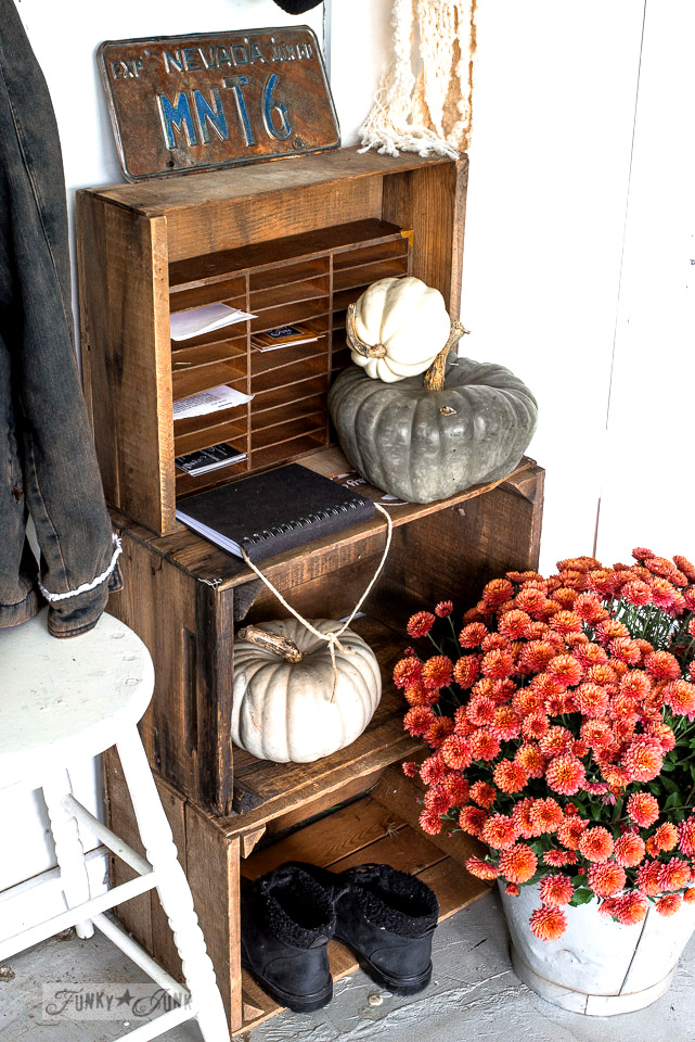 Fall decorating with stacked crates with teal pumpkins and salmon mums | funkyjunkinteriors.net