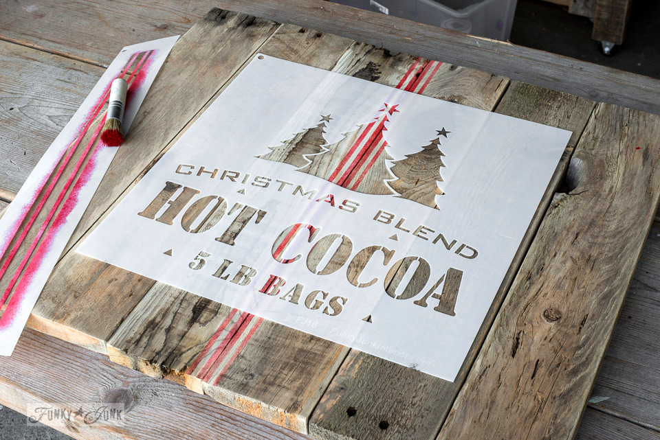 Stencilling a red and black crate styled Christmas themed hot cocoa TV tray, from pallet wood and Funky Junk's Old Sign Stencils | funkyjunkinteriors.net