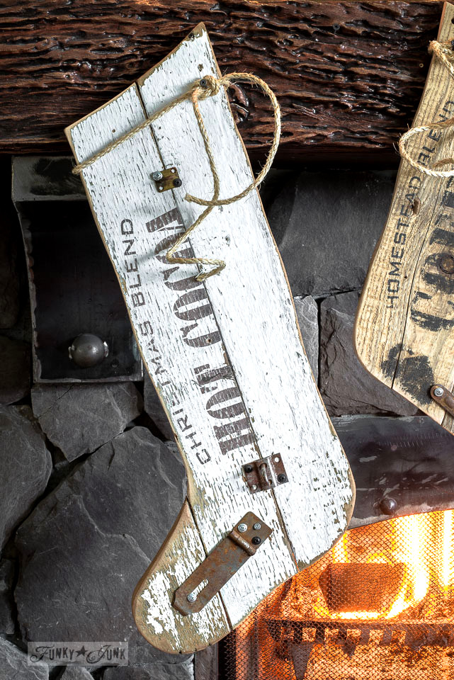 Old sign styled reclaimed wood Christmas stockings on a wreath filled fireplace mantel using Funky Junk's Old Sign Stencils   funkyjunkinteriors.net