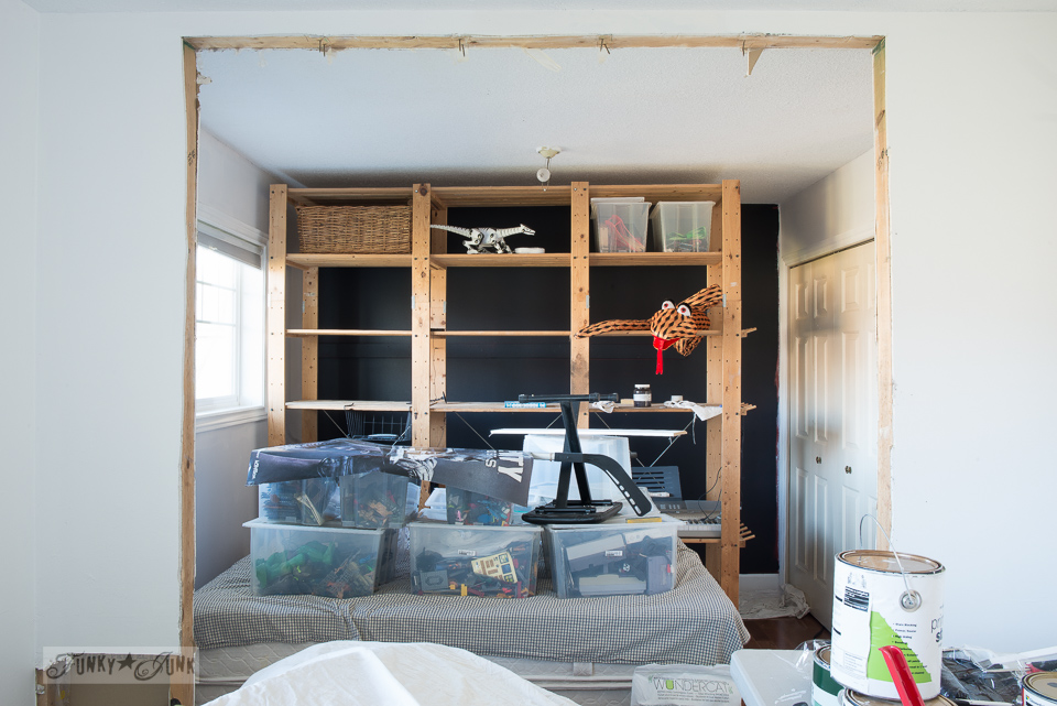 Teen boy's bedroom progress - wood shelves against a black wall | funkyjunkinteriors.net