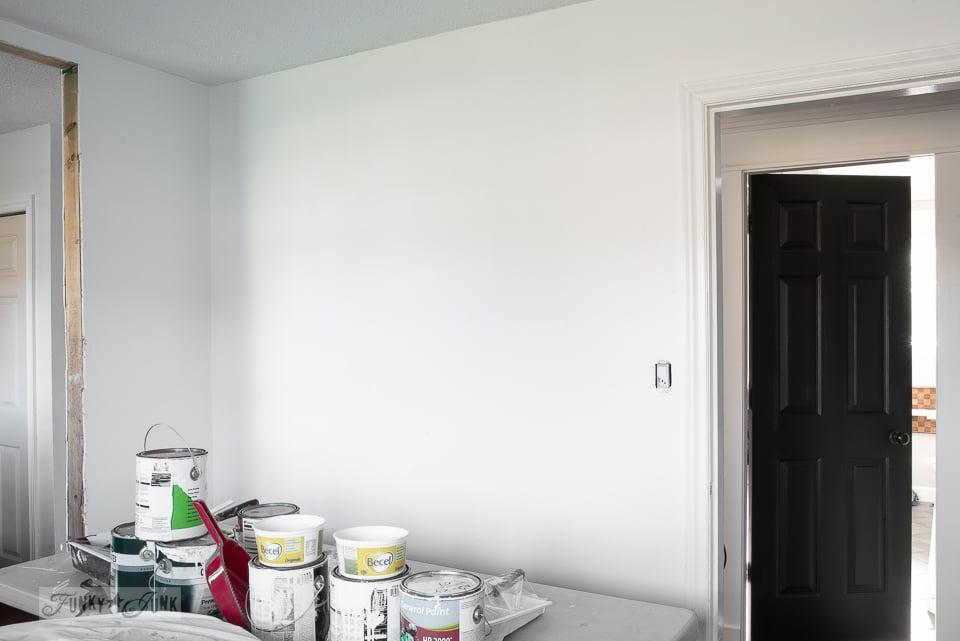 Teen boy's bedroom progress - white walls and a black door