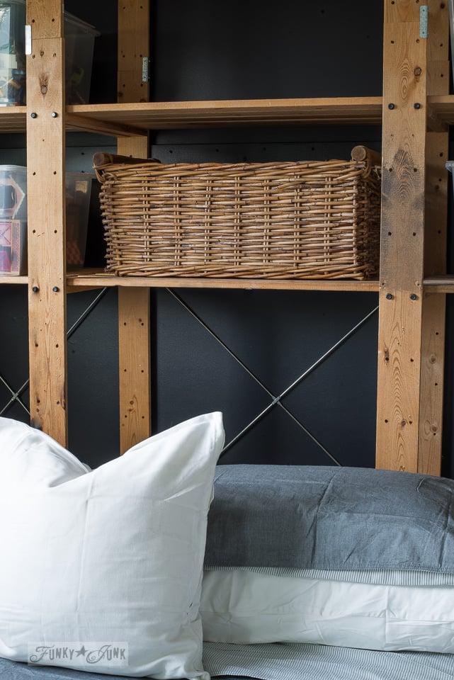 Teen boy's bedroom progress - wood shelves and wicker storage against a black wall | funkyjunkinteriors.net