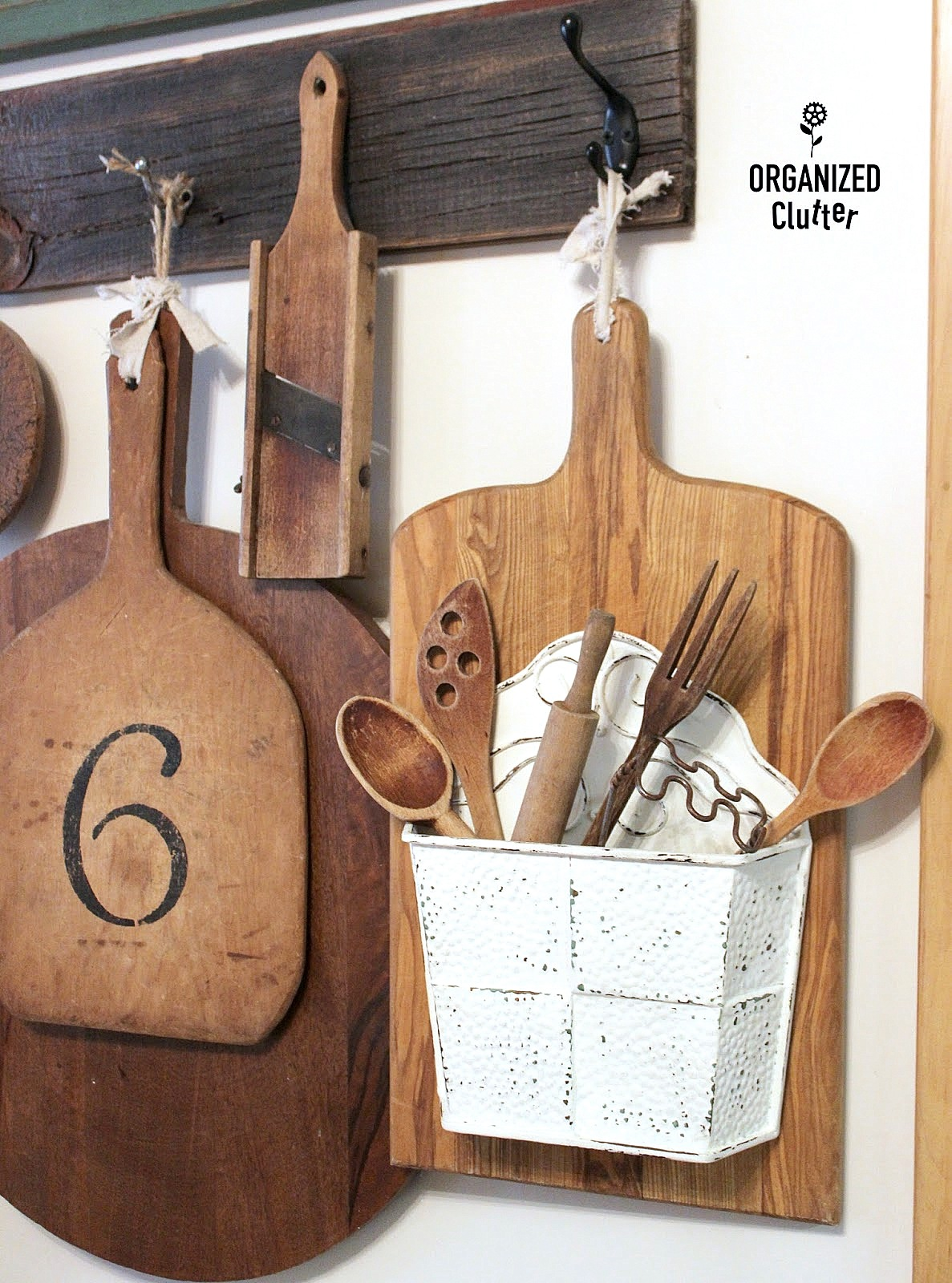 Repurposed cutting board wall pocket decor, by Organized Clutter, featured on Funky Junk Interiors