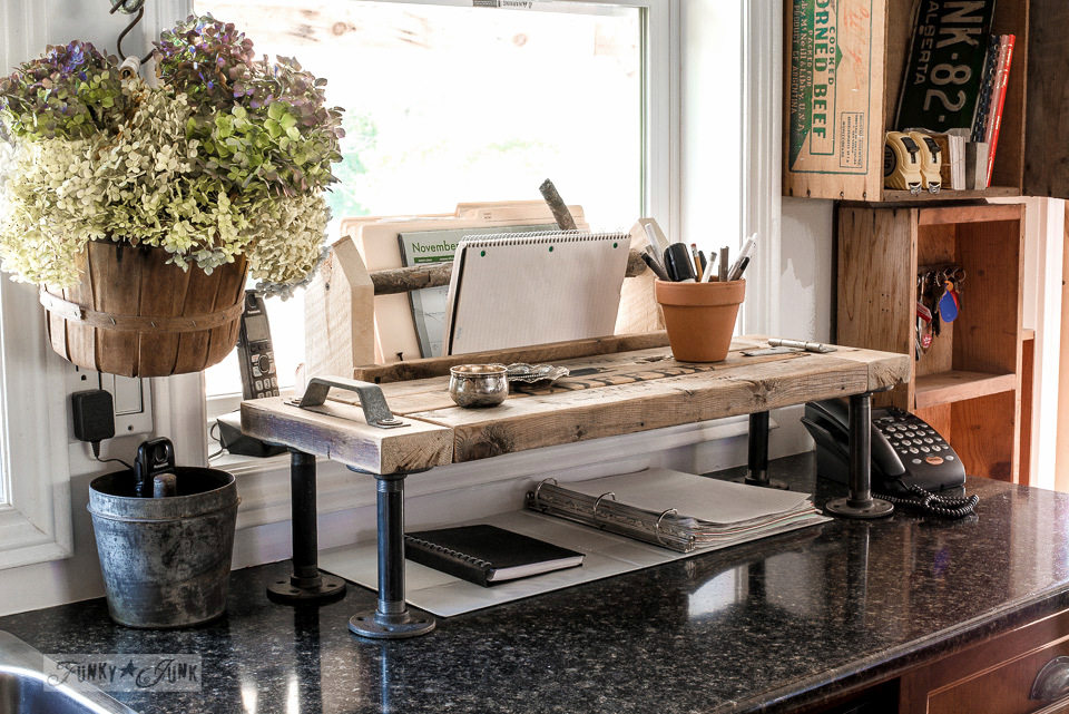 Simple but effective reclaimed wood toolbox file holder with a branch handle. Perfect for organizing paperwork near a phone. | funkyjunkinteriors.net