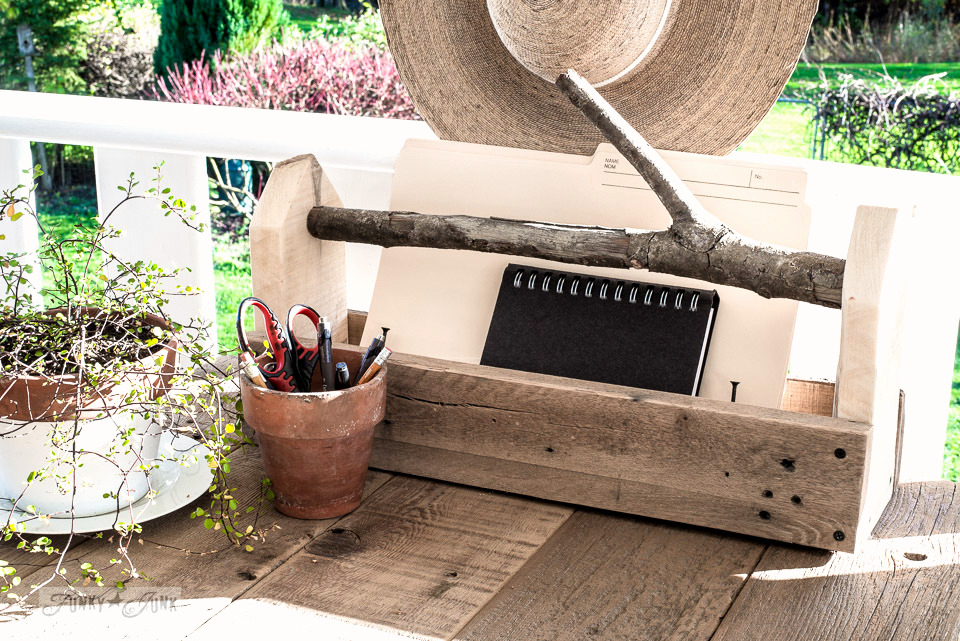 Simple yet effective reclaimed wood branch handled toolbox file holder for a phone station | funkyjunkinteriors.net