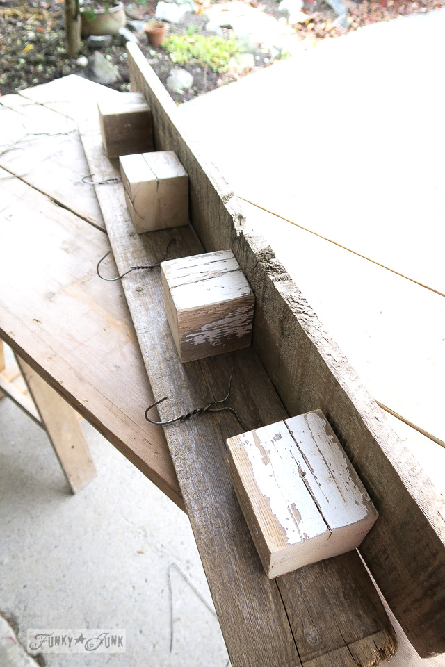 Dry fitting boards, blocks and hangers to create a reclaimed wood coat hook shelf | funkyjunkinteriors.net