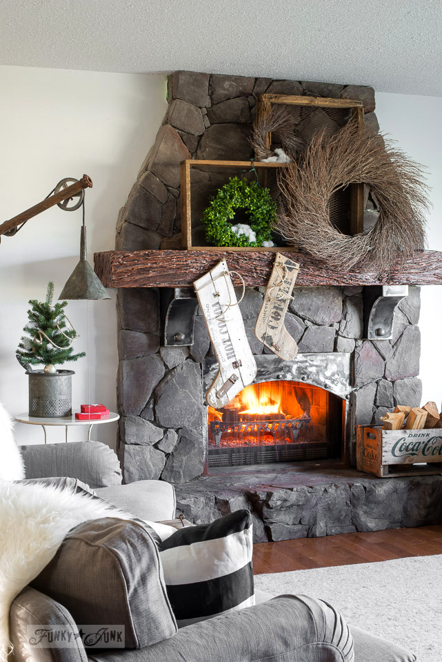 Reclaimed wood stockings on a wreath filled mantel, made with Funky Junk's Old Sign Stencils : funkyjunkinteriors.net