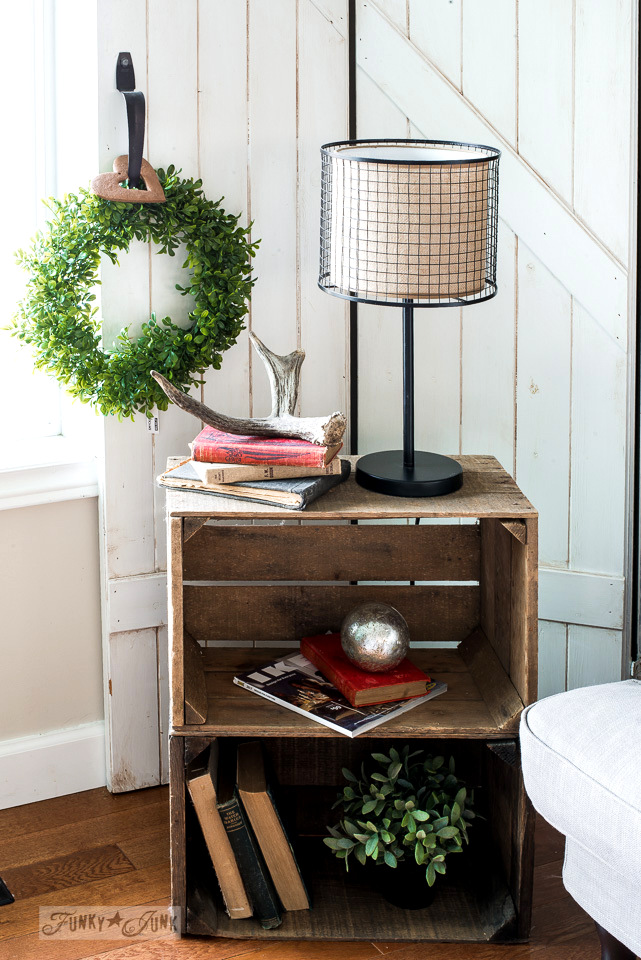Christmas living room tour with stacked crate side table, burlap metal lamp, antlers, and faux boxwood wreath from Ikea | funkyjunkinteriors.net
