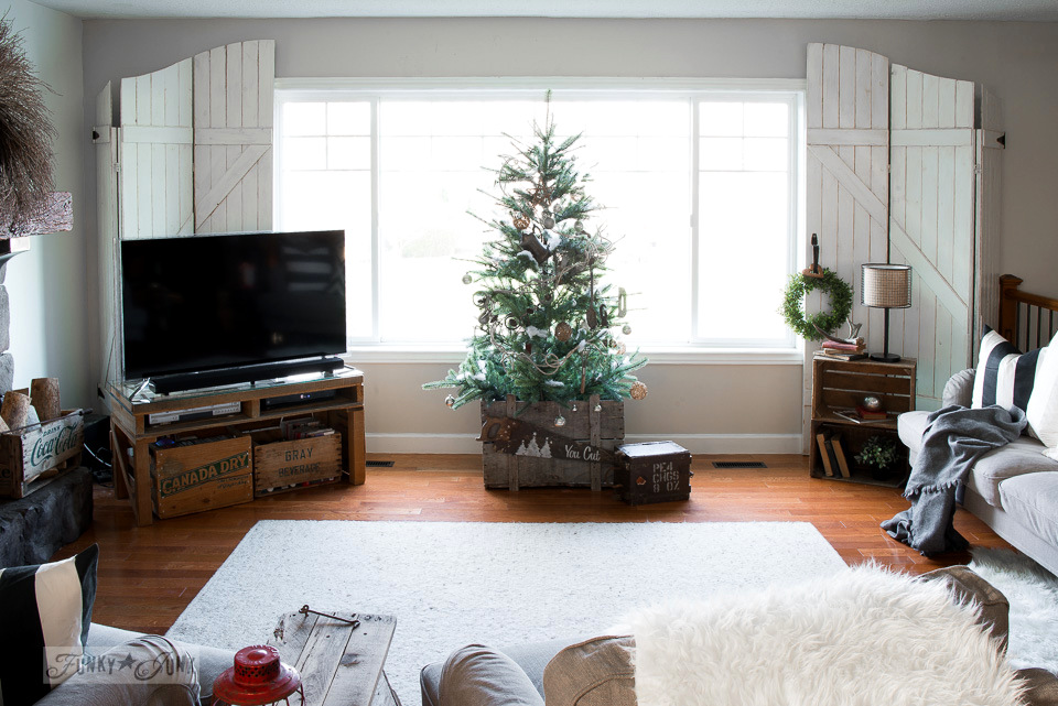 Christmas livingroom tour with old gate window screens, pallet TV stand, crate storage, and tree in a crate | funkyjunkinteriors.net
