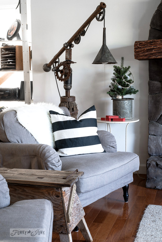 Christmas living room tour with Ikea Stocksund chairs, junk funnel lamp, and faux tree in a bait bucket | funkyjunkinteriors.net